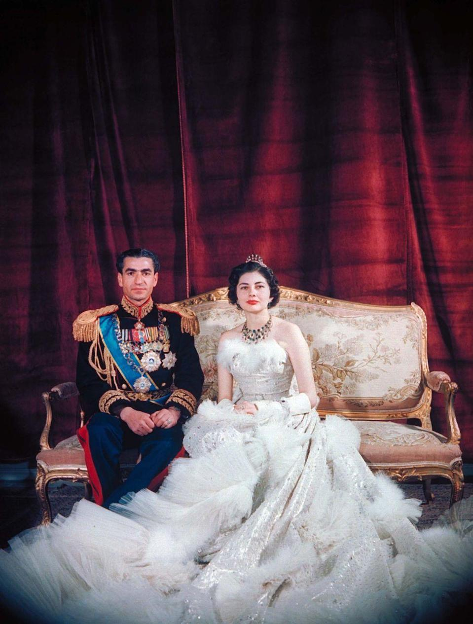 <p>Queen Soraya wore an elaborate feather, tulle, and crystal-embroidered ball gown designed by Christian Dior for her wedding to the Iranian monarch. The couple married in a traditional ceremony when Soraya was just 16 years old. The Shah repudiated her after seven years of marriage, when she was unable to produce an heir for the throne. </p>