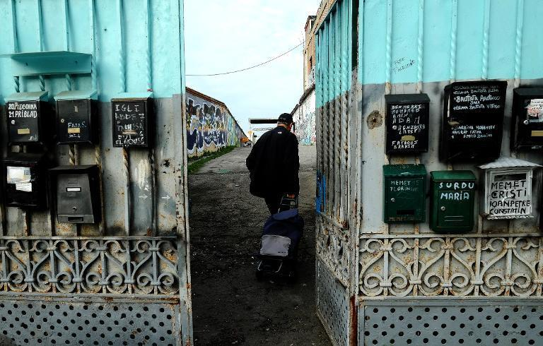 A visitor enters the Metropoliz Museum of the Other and the Elsewhere (MAAM), which is also home to 200 squatters, including Roma and people from all corners of the globe, in Rome, on November 25, 2014