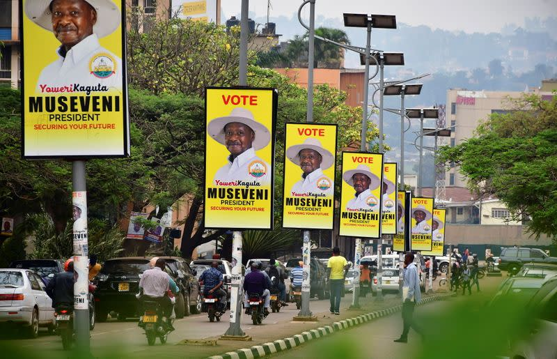 FILE PHOTO: Electoral campaign posters of Uganda's President Yoweri Museveni hang on street light poles in Kampala