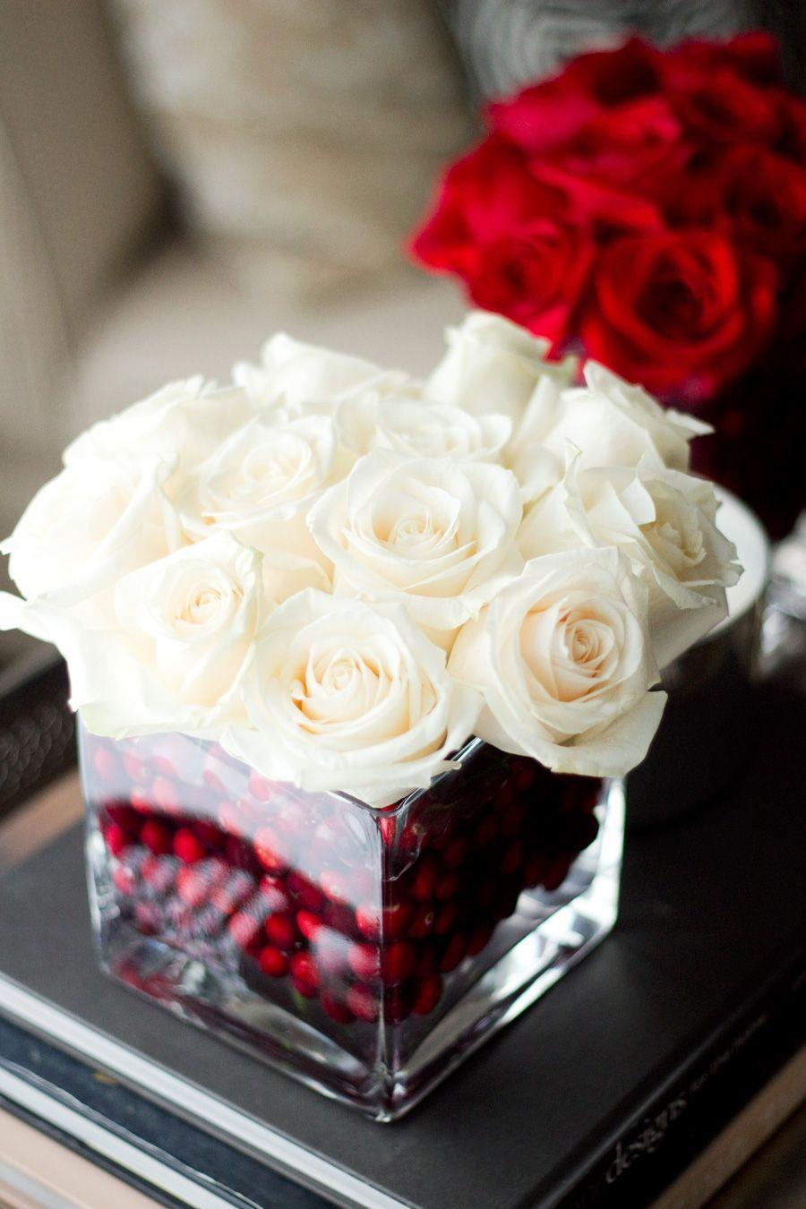 "<p>Get creative with the base filler of your winter floral arrangements—try filling a square vase with fake cranberries before inserting cream colored roses.</p><p>Get the tutorial at <a href=""http://notyourstandard.com/holiday-roses/"" rel=""nofollow noopener"" target=""_blank"" data-ylk=""slk:Not Your Standard"" class=""link rapid-noclick-resp"">Not Your Standard</a>.</p>"