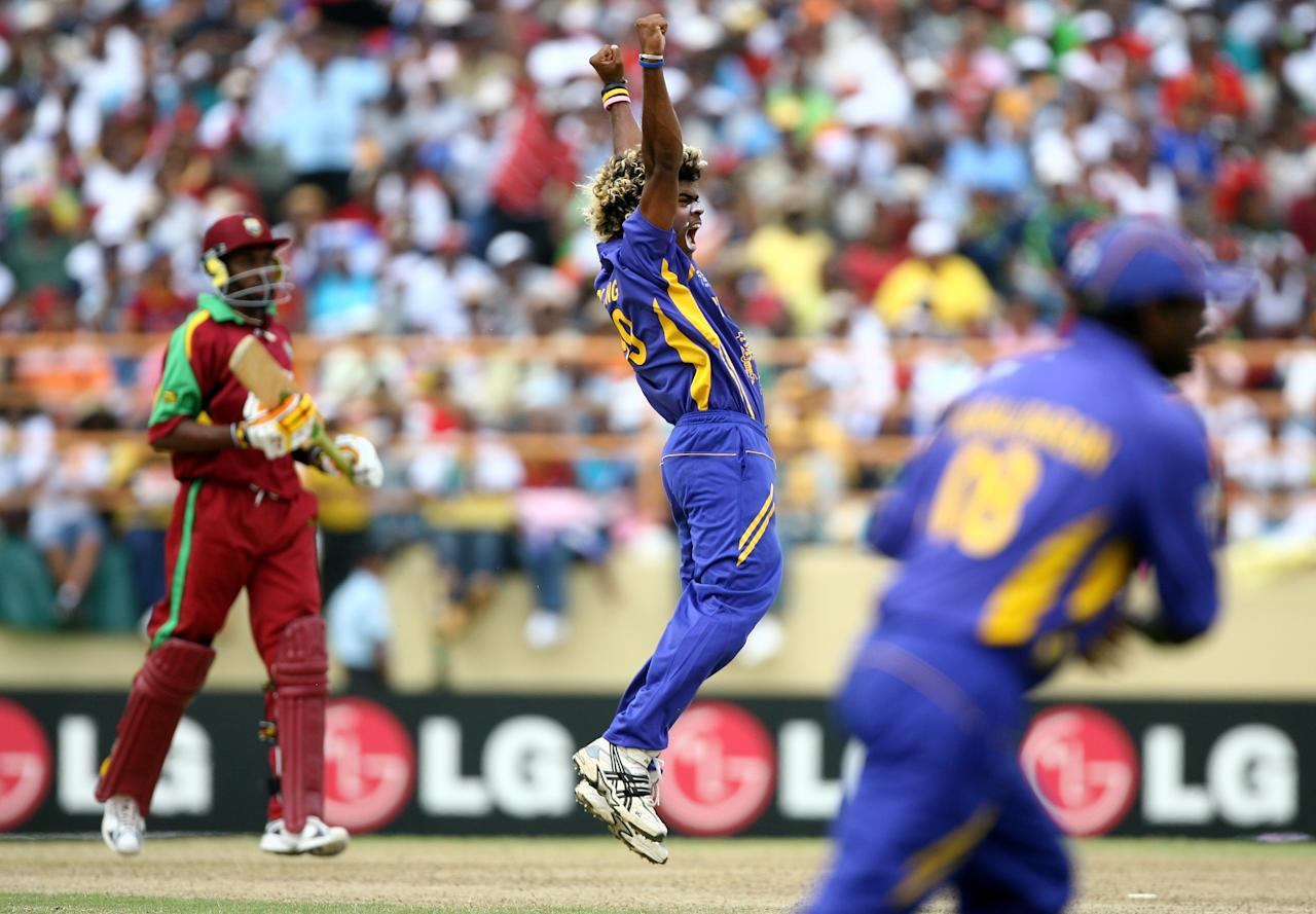 PROVIDENCE, GUYANA - APRIL 01:  Lasith Malinga of Sri Lanka celebrates his dismissal of Chris Gayle of West Indies during the ICC Cricket World Cup Super Eights match between West Indies and Sri Lanka at the Guyana National Stadium on April 1, 2007 in Providence, Guyana.  (Photo by Clive Mason/Getty Images)