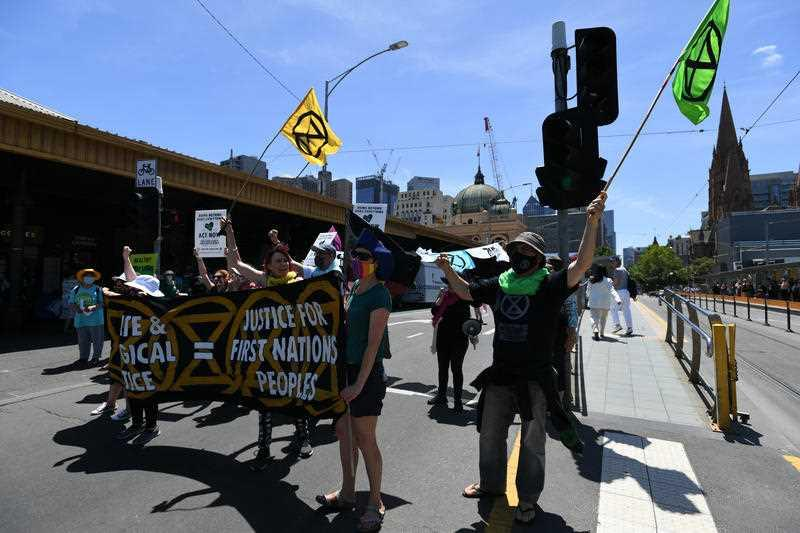 Protesters are seen during an Extinction Rebellion protest in Melbourne.