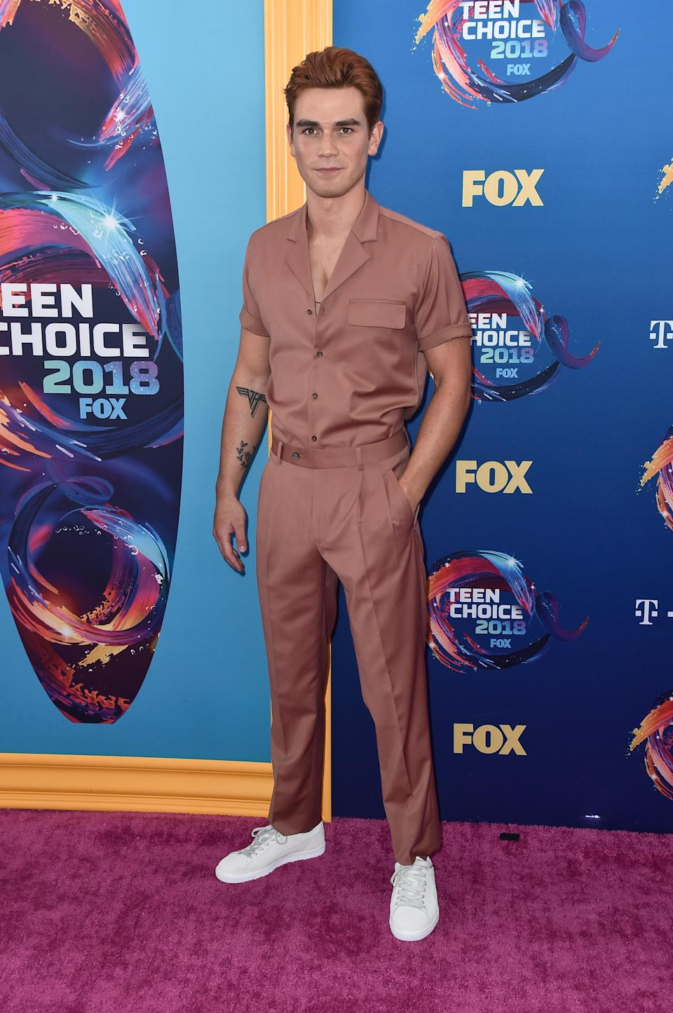 <p>Another 'Riverdale' star, another strong look. The show's male lead, Archie, opted to wear a colour co-ordinated shirt and trousers, paired with white trainers, to the 2018 Teen Choice Awards. <em>[Photo: Getty]</em> </p>