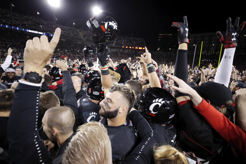 CINCINNATI, OH - OCTOBER 04: Cincinnati Bearcats players and fans celebrate after the game against the Central Florida Knights at Nippert Stadium on October 4, 2019 in Cincinnati, Ohio. Cincinnati defeated Central Florida 27-24. (Photo by Joe Robbins/Getty Images)