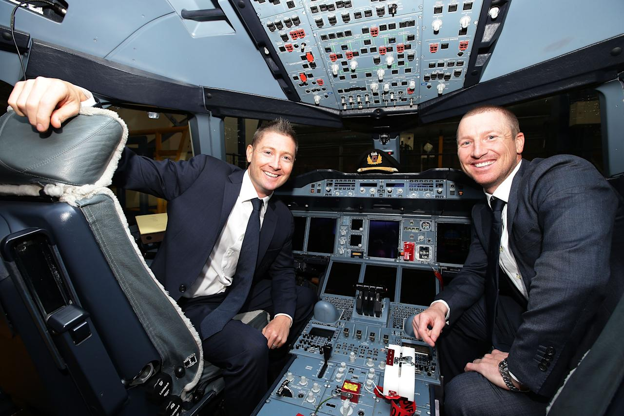 SYDNEY, AUSTRALIA - MAY 22:  Austalian captain Michael Clarke (L) and vice-captain Brad Haddin (R) pose in the cockpit of a Qantas A380 during the Cricket Australia Ashes official team farewell at Sydney International Airport on May 22, 2013 in Sydney, Australia.  (Photo by Matt King/Getty Images)
