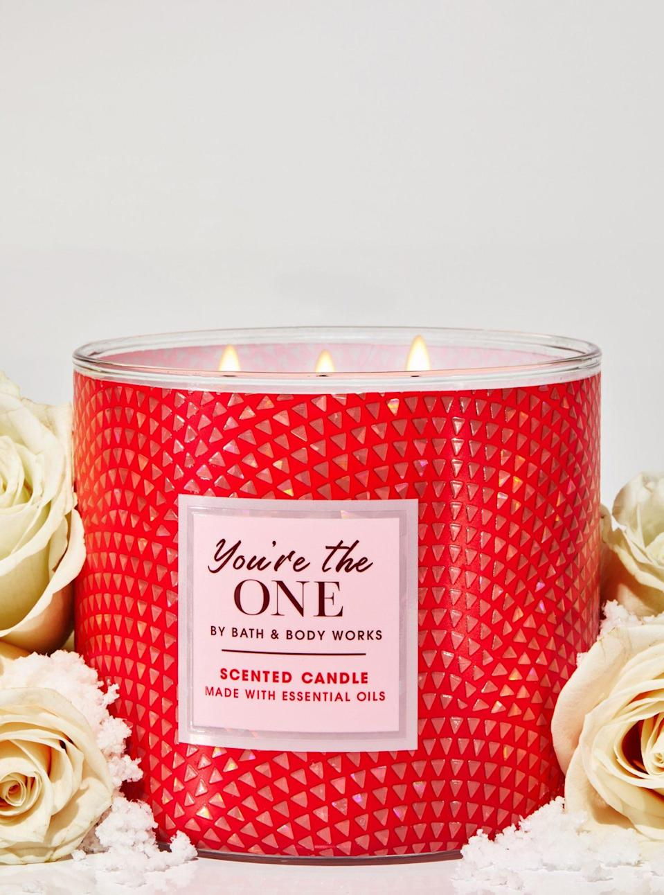 """<p>This popular, feminine fragrance is lovely all year round, but we love this 3-wick candle — in its iridescent, pink-and-red votive — for Valentine's Day gifting. White birch, rose and strawberry nectar are the three main notes you'll smell, and boy does it ever fill a room. </p> <p><strong>Buy It!</strong> $24.50, <a href=""""https://www.pntra.com/t/8-4267-131940-44295?sid=PEOTheBestValentinesInspiredCandlesfortheSingleorTakenCandleLoverInYourLifehchubbHomGal12564975202102I&url=https%3A%2F%2Fwww.bathandbodyworks.com%2Fp%2Fyoure-the-one-3-wick-candle-026182137.html"""" rel=""""nofollow noopener"""" target=""""_blank"""" data-ylk=""""slk:bathandbodyworks.com"""" class=""""link rapid-noclick-resp"""">bathandbodyworks.com</a></p>"""
