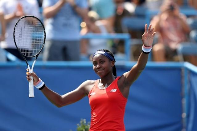 US teenager Coco Gauff, waving to Washington fans in July, has been given a wildcard invitation into the main draw of the US Open tennis championships (AFP Photo/Rob Carr)