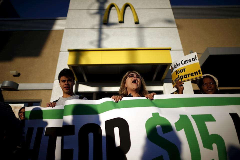 Fast-food workers and their supporters join a nationwide protest for higher wages and union rights outside McDonald's in Los Angeles, California, United States, November 10, 2015. REUTERS/Lucy Nicholson
