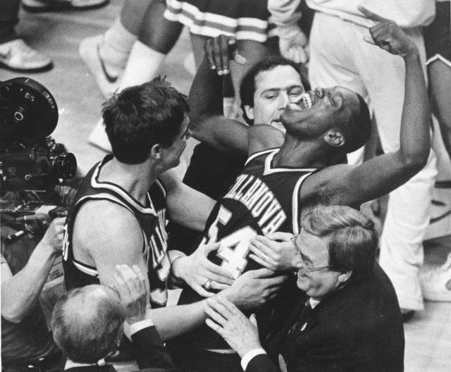 FILE - In this April 1, 1985, file photo, Villanova's Ed Pinckney (54) yells out as he is surrounded by teammates after the Wildcats defeated Georgetown for the national championship in the Final Four of the NCAA college basketball tournament in Lexington, Ky. (AP Photo/Gary Landers, File)