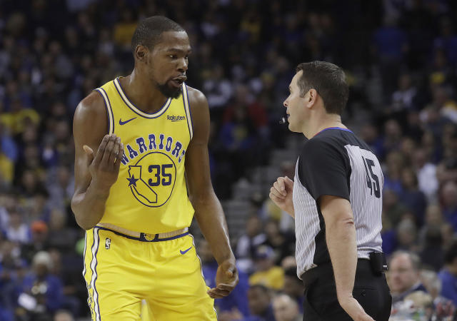 Golden State Warriors forward Kevin Durant (35) talks with referee Brian Forte during the first half of an NBA basketball game between the Warriors and the Phoenix Suns in Oakland, Calif., Sunday, March 10, 2019. (AP Photo/Jeff Chiu)