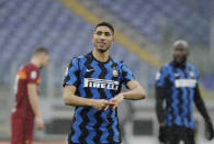 Inter Milan's Achraf Hakimi celebrates after scoring his side's 2nd goal during a Serie A soccer match between Roma and Inter Milan at Rome's Olympic stadium, Sunday, Jan. 10, 2021. (AP Photo/Gregorio Borgia)