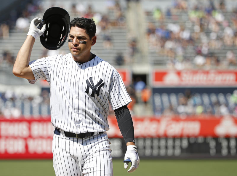 New York Yankees Jacoby Ellsbury (22) reacts as he removes his helmet after flying out to center field with a runner on first during the eighth inning of a baseball game against the Baltimore Orioles in New York, Thursday, July 21, 2016. (AP Photo/Kathy Willens)