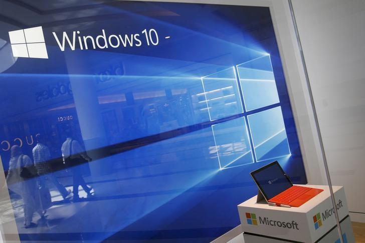 A display for the Windows 10 operating system is seen in a store window at the Microsoft store at Roosevelt Field in Garden City