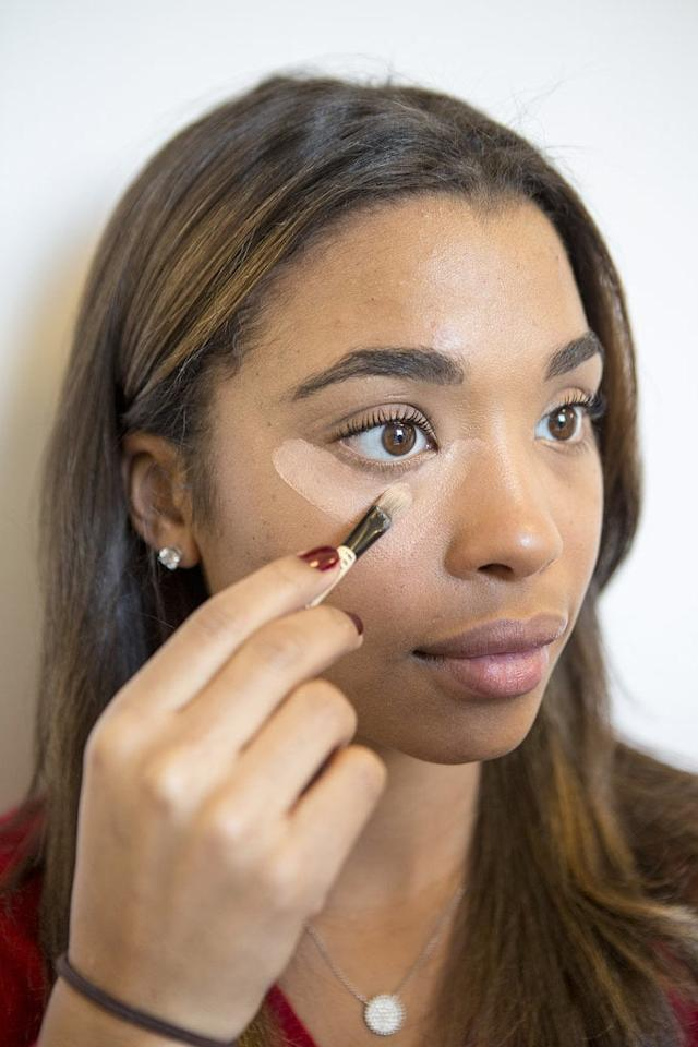 "<p><strong>Tip #5:</strong> While we like to blend concealer using our fingers, the <a href=""https://www.popsugar.com/beauty/photo-gallery/34375334/image/34375352/Eye-Blending-Brush"" class=""ga-track"" data-ga-category=""Related"" data-ga-label=""http://www.popsugar.com/beauty/Which-Makeup-Brush-Should-I-Use-34375334#photo-34375352"" data-ga-action=""In-Line Links"">best makeup brush</a> to buy is flat with densely packed bristles. A dome-shaped tool like the <a href=""https://www.popsugar.com/buy/Sigma-Beauty-F65-Large-Concealer-Brush-558961?p_name=Sigma%20Beauty%20F65%20Large%20Concealer%20Brush&retailer=sigmabeauty.com&pid=558961&price=21&evar1=bella%3Aus&evar9=37137221&evar98=https%3A%2F%2Fwww.popsugar.com%2Fbeauty%2Fphoto-gallery%2F37137221%2Fimage%2F37137225%2FTip-5-While-we-like-blend-concealer-using-our-fingers-best&list1=makeup%2Cconcealer%2Cnatural%20beauty%2Cbeauty%20how%20to%2Cbeauty%20tips%2Cbeginner%20beauty&prop13=mobile&pdata=1"" rel=""nofollow"" data-shoppable-link=""1"" target=""_blank"" class=""ga-track"" data-ga-category=""Related"" data-ga-label=""https://www.sigmabeauty.com/f65-large-concealer.html"" data-ga-action=""In-Line Links"">Sigma Beauty F65 Large Concealer Brush</a> ($21) will help you get into the smallest crevices. </p> <p><strong>Tip #6:</strong> If you want to erase tired, sagging eyes, there's an important product you have to apply even before concealer - corrector. While your concealer product will even out your dark circles to match your skin tone, a <a href=""https://www.popsugar.com/beauty/Slimming-Makeup-Tips-36166846"" class=""ga-track"" data-ga-category=""Related"" data-ga-label=""http://www.popsugar.com/beauty/Slimming-Makeup-Tips-36166846"" data-ga-action=""In-Line Links"">color corrector brightens the entire area</a> by neutralizing the blue or green undertones. ""Correctors come in peach or bisque tones,"" said Bobbi Brown makeup artist Kim Soane. ""The peach color eliminates gray and green, and bisque (or pink) takes away a gray/blue/purple undereye.""</p> <p><strong>Tip #7:</strong> You've probably been dotting concealer on in a half-moon shape for years, but an inverted triangle is the better strategy. Not only does it help draw attention upward toward the eye, but it also helps <a href=""https://www.popsugar.com/beauty/How-Contour-Highlight-Your-Face-37060432"" class=""ga-track"" data-ga-category=""Related"" data-ga-label=""http://www.popsugar.com/beauty/How-Contour-Highlight-Your-Face-37060432"" data-ga-action=""In-Line Links"">sculpt out the cheekbones</a>. Make sure to extend concealer all the way to the inner corner of the eye.</p>"