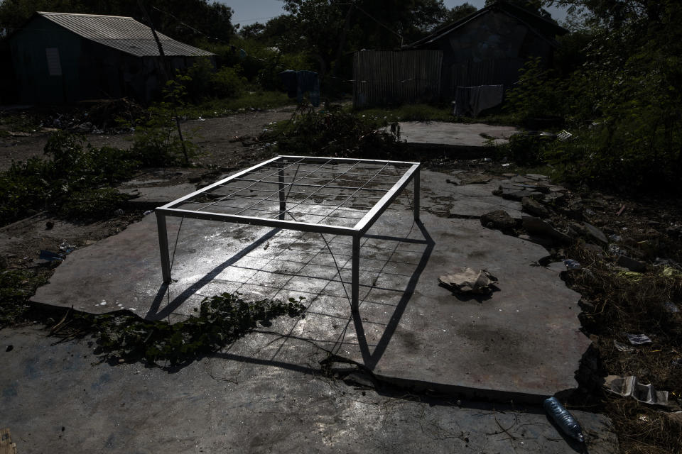 An abandoned bed frame sits in the La Piste neighborhood, in Port-au-Prince, Haiti, Friday, Sept. 17, 2021. Gunmen laid siege to the encampment in June, a neighborhood of deaf and disabled Haitians relocated there by the International Red Cross after the 2010 earthquake leveled the capital. This time it was the police leading an assault at dusk. (AP Photo/Rodrigo Abd)