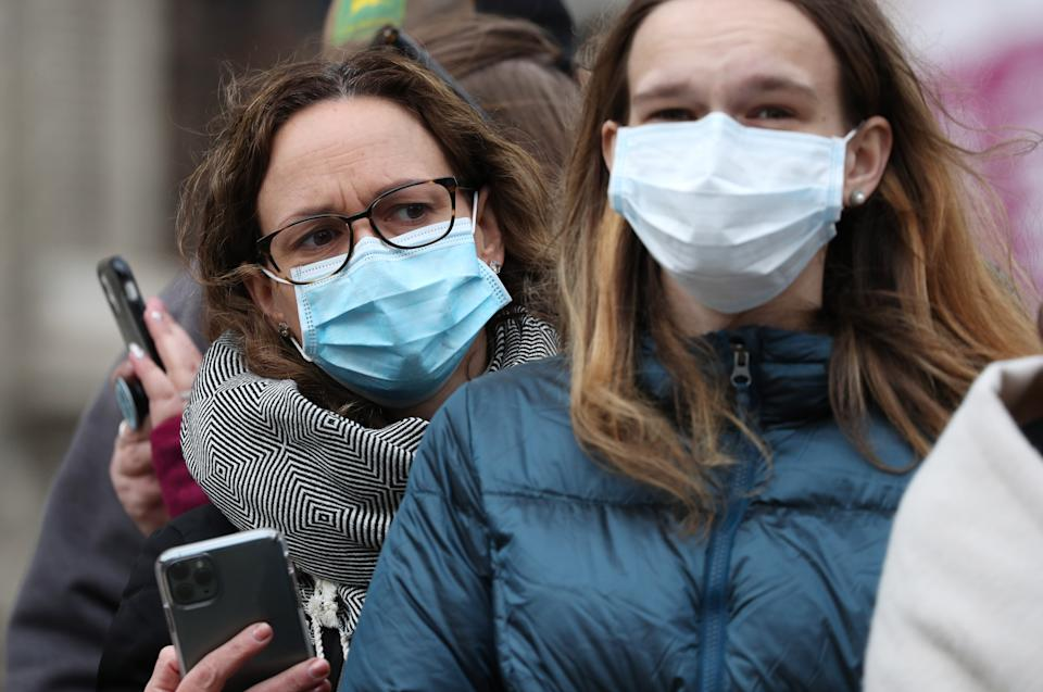 Spectators wearing masks to protect against coronavirus outside the Commonwealth Service at Westminster Abbey, London on Commonwealth Day. The service is the Duke and Duchess of Sussex's final official engagement before they quit royal life. (Photo by Jonathan Brady/PA Images via Getty Images)
