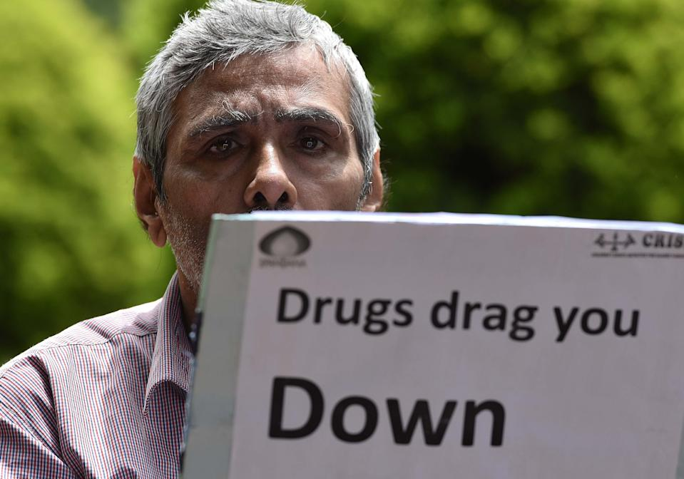 BENGALURU, INDIA - JUNE 26: A rehabilitated person takes part in an awareness campaign with other victims and doctors along with the activists on the International Day against Drug Abuse and Illicit Trafficking at Cubbon Park, on June 26, 2018 in Bengaluru, India. The International Day against Drug Abuse and Illicit Trafficking is an effort of the United Nations aimed at strengthening action and spreading awareness about drug abuse and illegal drug trade in the world. (Photo by Arijit Sen/Hindustan Times via Getty Images)