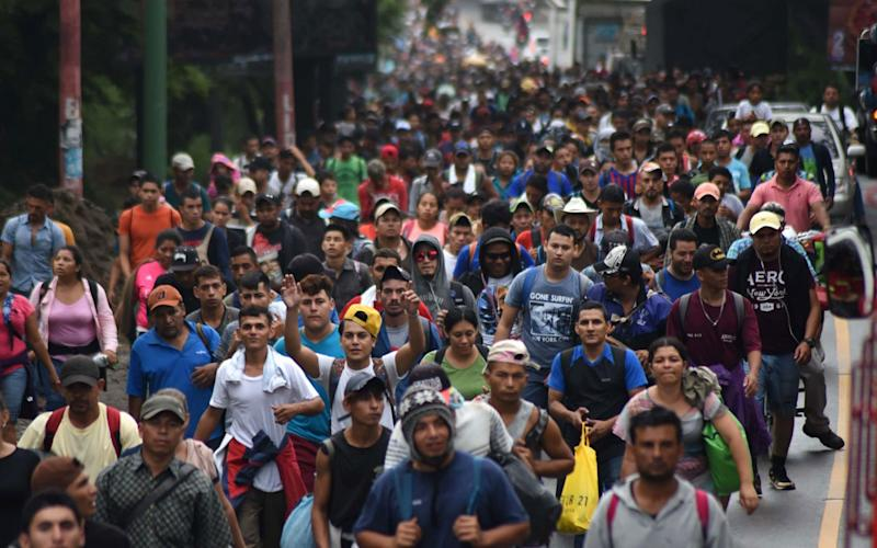 The migrant caravan, pictured passing through Guatemala. It is now believed to be around 3,000 people strong - AFP