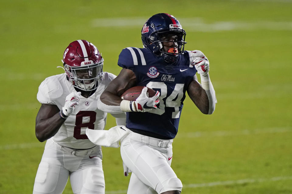 Mississippi tight end Kenny Yeboah (84) runs past Alabama linebacker Christian Harris (8) for long yardage during the first half of an NCAA college football game in Oxford, Miss., Saturday, Oct. 10, 2020. (AP Photo/Rogelio V. Solis)
