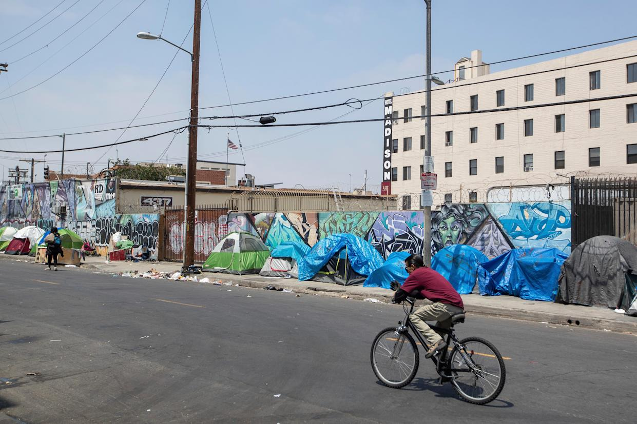 Homeless people and their tents line a Skid Row street on Friday, May 31, 2019 in Downtown Los Angeles five days before Los Angeles officials are set to release the region's official 2019 homeless count on June 4th.