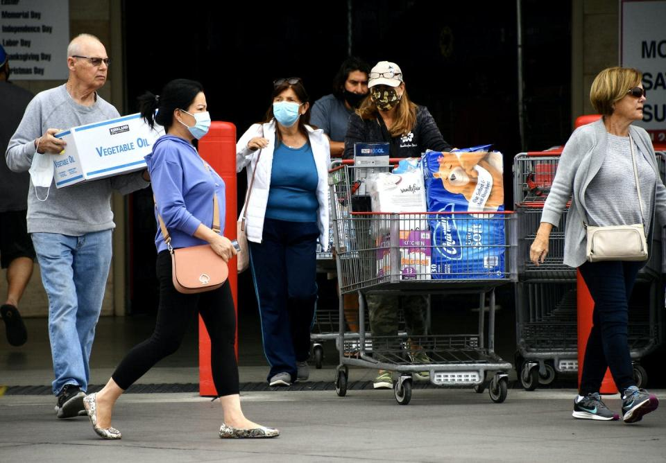 shoppers mostly all wearing masks