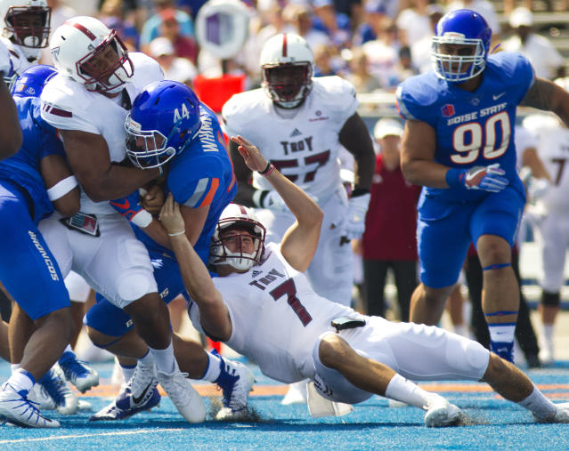 Troy running back Josh Anderson (33) is stopped at the line of scrimmage by Boise State safety Jace Richter (44) before Troy quarterback Kaleb Barker (7) can let go of the ball during an NCAA college football game Saturday, Sept. 2, 2017, in Boise. (Pat Sutphin/The Times-News via AP)