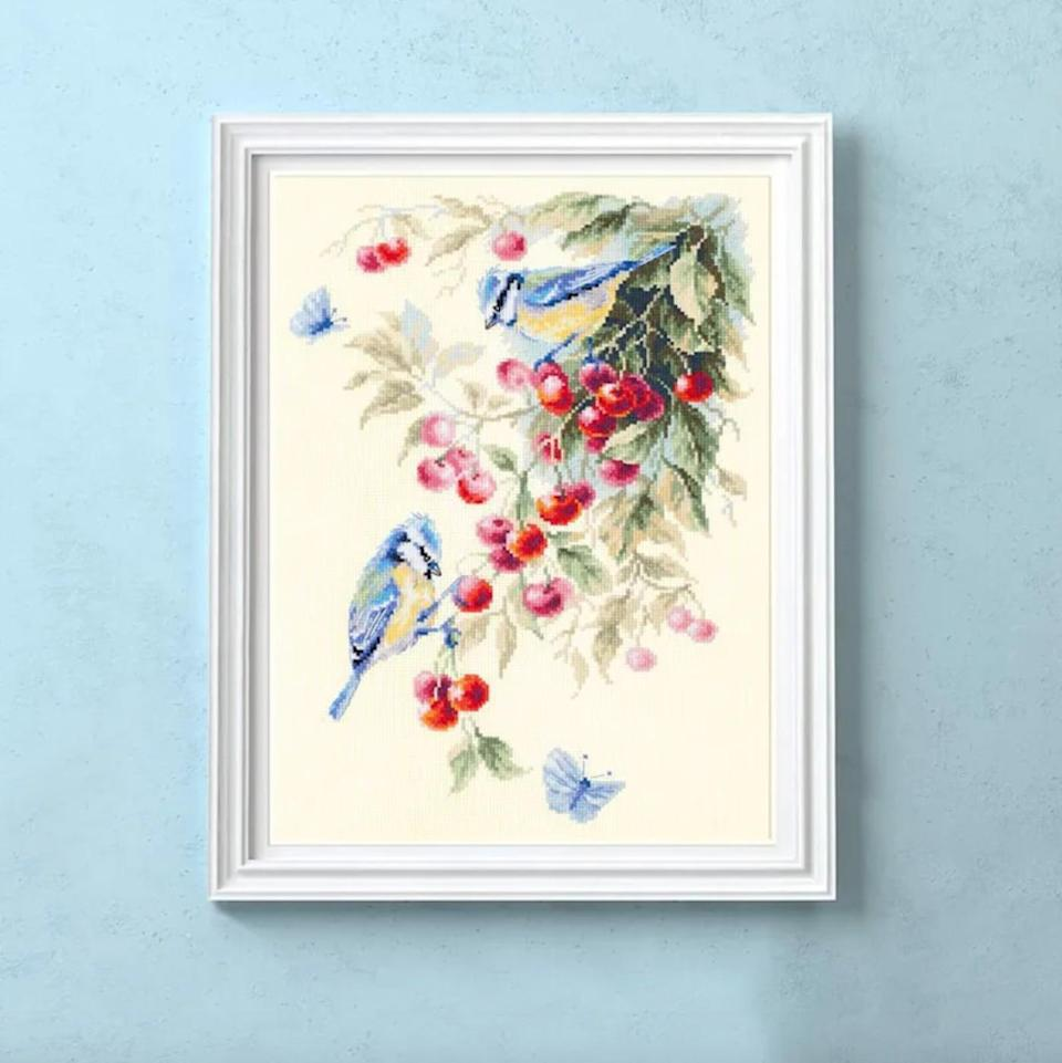 """<p>For birdwatchers and other ornithologists, try your hand at this beautiful backyard scene—a pair of bluebirds sharing a bough of berries. It has a painterly quality due to the use of open space—mimicking light—on the canvas.</p> <p><strong><em>Shop Now:</em></strong><em> Solar Stitch Blue Birds with Berries Cross Stitch Kit, $33, <a href=""""https://www.awin1.com/cread.php?awinmid=6220&awinaffid=272513&clickref=MSL10ofOurFavoriteCrossStitchKitsforBeginnersaharperDIYGal7998715202010I&p=https%3A%2F%2Fwww.etsy.com%2Flisting%2F708090286%2Fcross-stitch-kit-hand-embroidery-flowers"""" rel=""""nofollow noopener"""" target=""""_blank"""" data-ylk=""""slk:etsy.com"""" class=""""link rapid-noclick-resp"""">etsy.com</a></em><em>.</em></p>"""