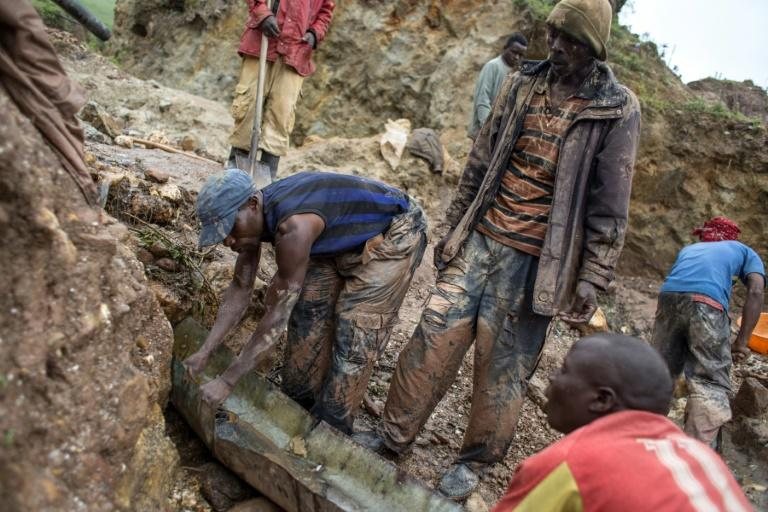 Sorting and washing rocks at a cassiterite mining site near Numbi in eastern Democratic Republic of Congo