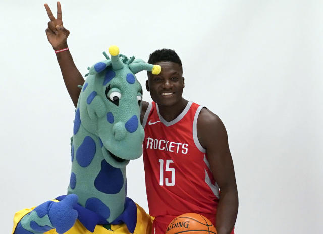 """<p>Cameraman: """"The only thing we could find that is as tall as you is this weird giraffe thing.""""<br>Clint Capela: """"Cool, we're best friends now.""""<br>(AP) </p>"""