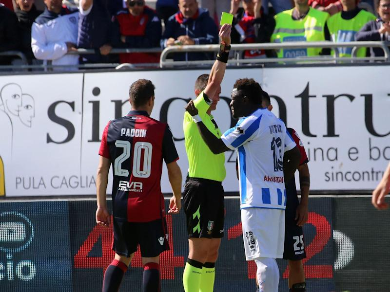 Sulley Muntari has been banned after being issued with a yellow card for reporting racial abuse: Getty