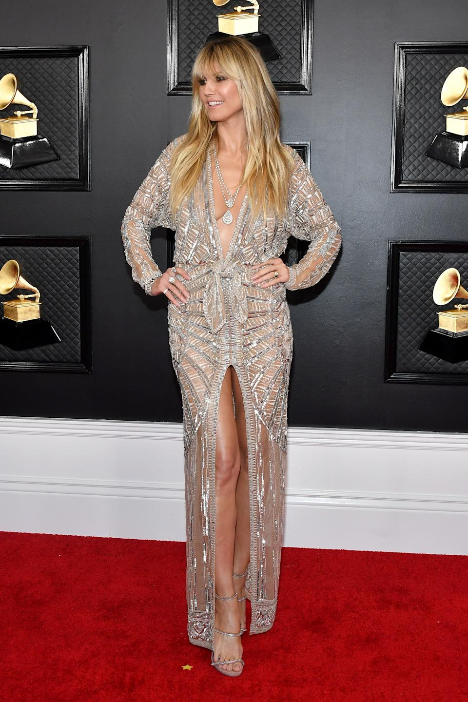 """The pattern is glam as can be, but the high front slit and excessively low neckline make it look a bit flimsy. But hey: it's definitely better than <a href=""""https://www.huffingtonpost.ca/entry/grammys-2019-red-carpet-best-worst_ca_5cd5889de4b07bc72978f2e2"""" target=""""_blank"""" rel=""""noopener noreferrer"""">what she wore last year</a>!"""