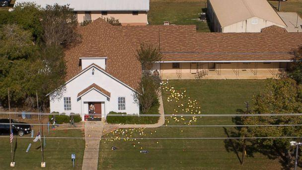 PHOTO: Flags mark evidence on the lawn of the First Baptist Church in Sutherland Springs, Texas, Nov. 6, 2017, a day after the mass shooting.  (Jay Janner/Austin American-Statesman via AP)