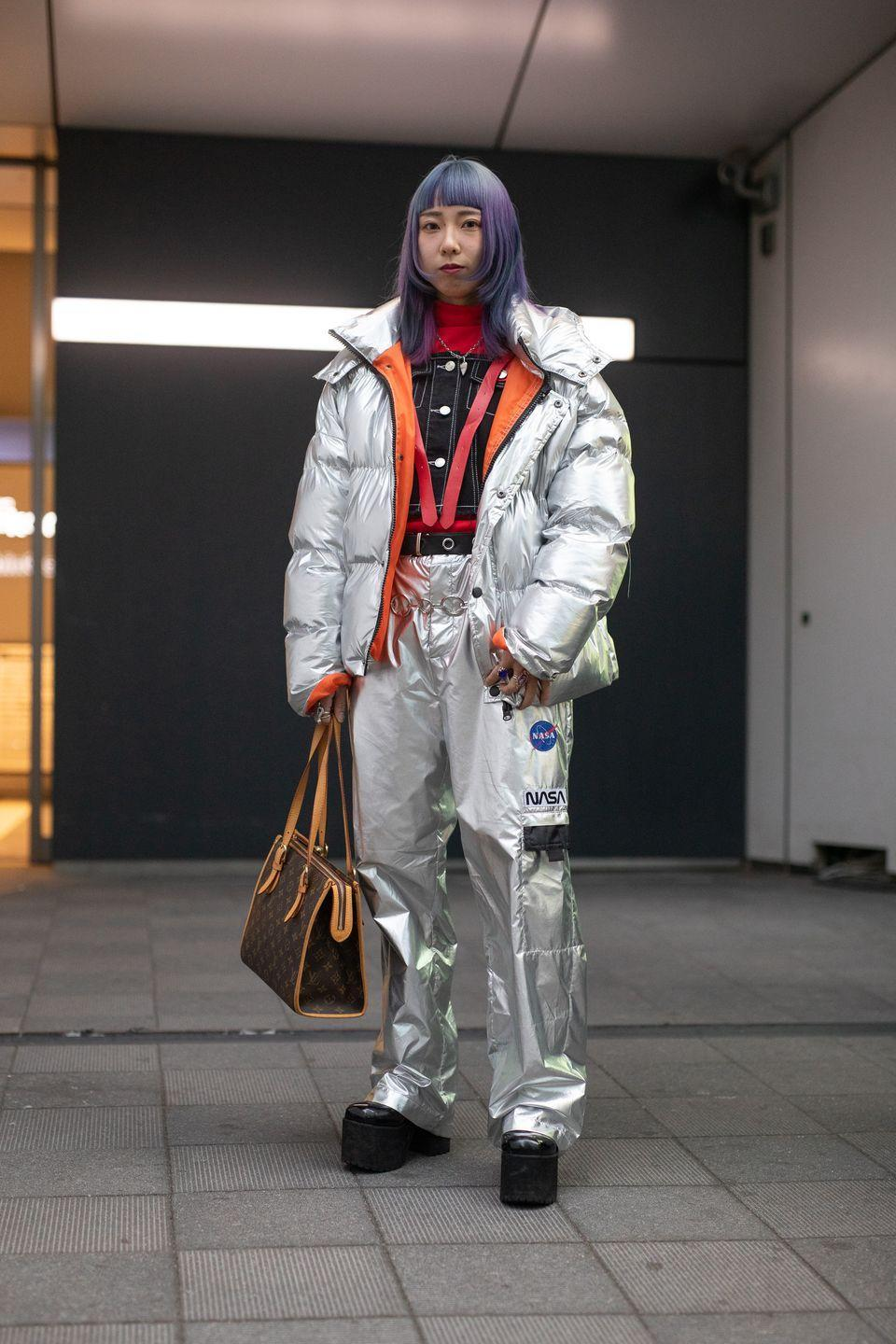 """<p>Alexa, play """"NASA"""" by Ariana Grande. Space-age metallics and iridescent accessories are taking over the fashion world at the moment. Go all-in with logo patches and <em>lots </em>of matte silver.<br><br></p>"""
