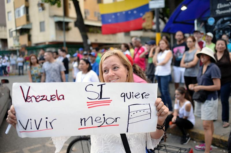 """Venezuela wants to live better"" -- voters celebrate in Caracas after taking part in an opposition-organized ballot challenging embattled Venezuelan President Nicolas Maduro's plan to rewrite the constitution"