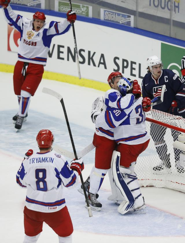 Russia's players Tryamkin, Mironov, Slepyshev and goalie Vasilevski celebrate their victory past Barber of the U.S. in their IIHF Ice Hockey World Championship quarter-final match in Malmo