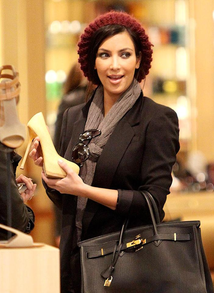 "The day before her sister Kourtney gave birth to her baby boy, Mason Dash, Kim Kardashian was spotted doing a little last minute shopping at Barneys in Los Angeles. A post-pregnancy gift for her sister perhaps? Rafa/<a href=""http://www.infdaily.com"" target=""new"">INFDaily.com</a> - December 13, 2009"