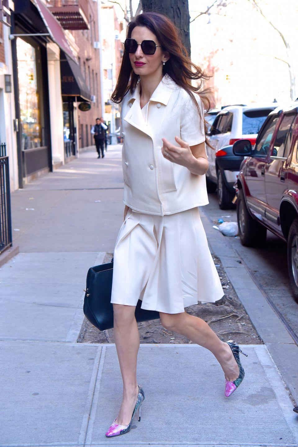 <p>For workwear conundrums, we always look to Amal Clooney. Here, she is expertly demonstrating how to make the skirt suit work for the office. Opt for light colours and accessorise with sunglasses and floral prints.</p>