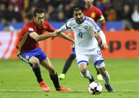 Football Soccer - Spain v Israel - 2018 World Cup Qualifying European Zone - Group G - El Molinon Stadium, Gijon, Spain, 24/3/17 Spain's Sergio Busquets (L) and Israel's Lior Refaelov in action. REUTERS/Eloy Alonso