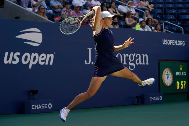 Iga Swiatek hits a forehand during her defeat by Belinda Bencic