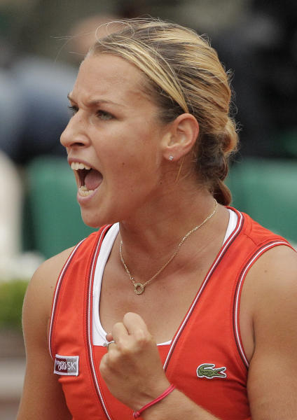 Slovakia's Dominika Cibulkova reacts as she plays Belarus' Victoria Azarenka during their fourth round match in the French Open tennis tournament at the Roland Garros stadium in Paris, Sunday, June 3, 2012. (AP Photo/Michel Spingler)