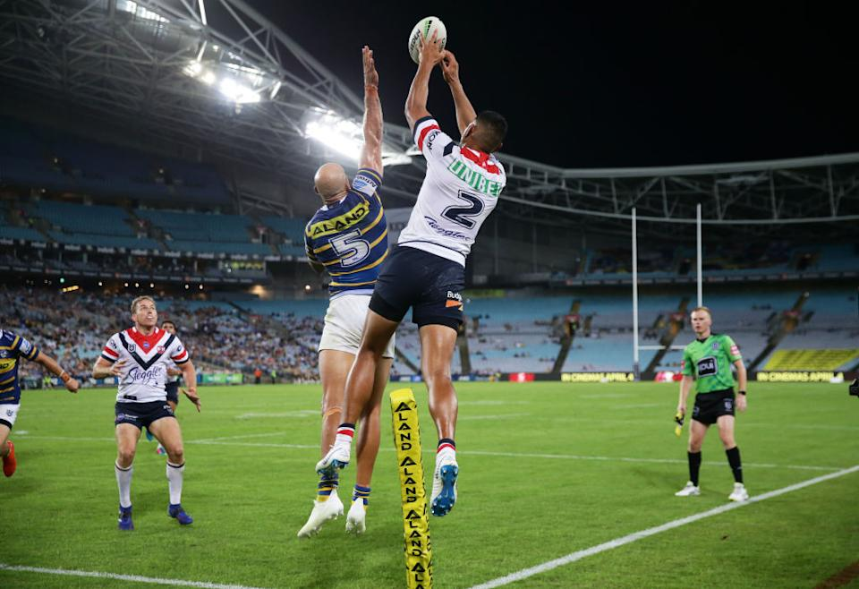 Daniel Tupou of the Roosters jumps and taps the ball back for a try to Mitchell Aubusson of the Roosters during the round three NRL match between the Parramatta Eels and the Sydney Roosters at ANZ Stadium on March 29, 2019 in Sydney, Australia.