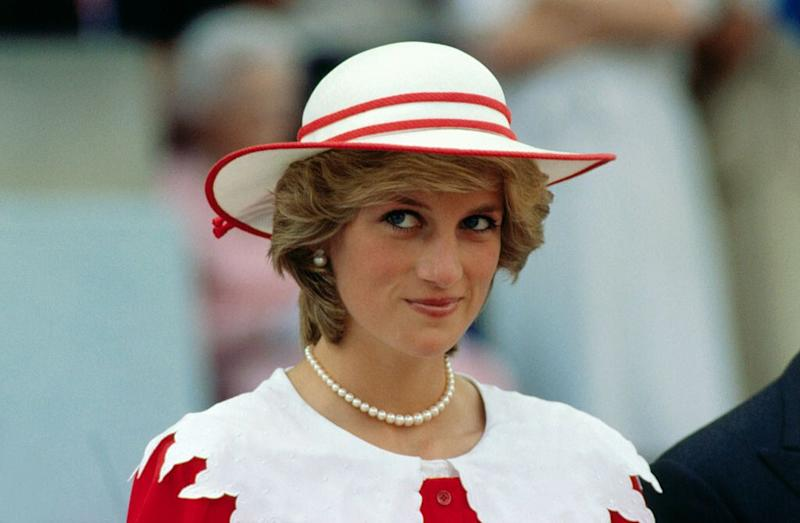 Diana, Princess of Wales, wears an outfit in the colors of Canada during a state visit to Edmonton, Alberta, with her husband.