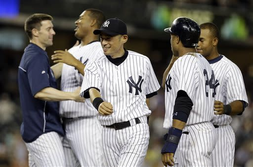 New York Yankees' Ichiro Suzuki, center, of Japan, celebrates with teammates after a baseball game against the Baltimore Orioles, Friday, July 5, 2013, in New York. The Yankees won the game 3-2. (AP Photo/Frank Franklin II)