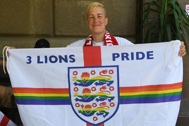 England fan and LGBT+ rights campaigner Di Cunningham displays a rainbow flag before England's first World Cup match: AFP/Getty Images