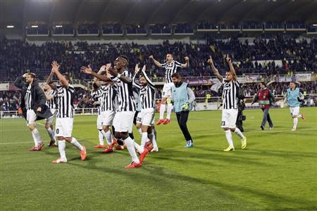 Juventus' players celebrate after defeating Fiorentina in their Europa League round of 16 second leg soccer match in Florence
