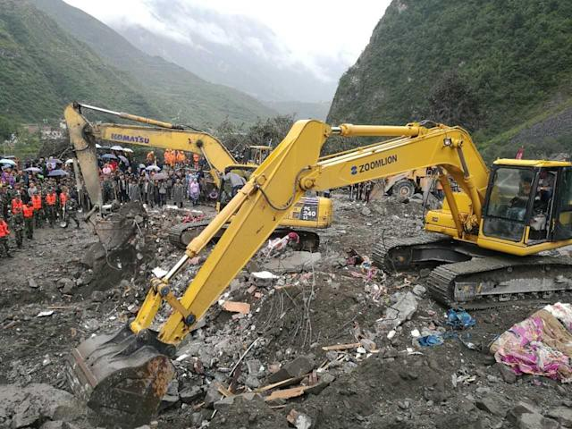<p>The excavator works at the accident site after a landslide at Xinmo Village of Maoxian County on June 24, 2017 in Tibetan and Qiang Autonomous Prefecture, Sichuan Province of China. (Photo: VCG/VCG via Getty Images) </p>
