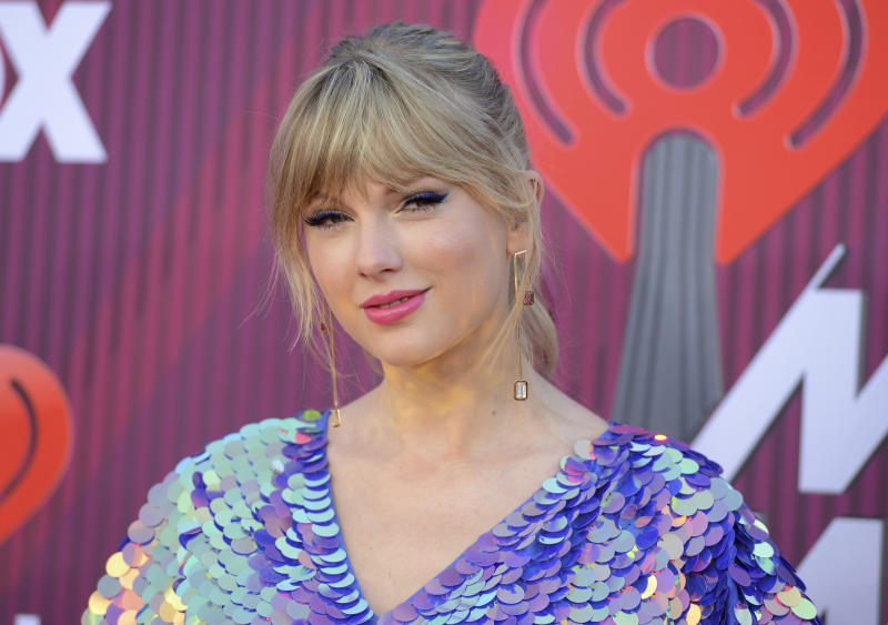 FILE - In this March 14, 2019, file photo, Taylor Swift arrives at the iHeartRadio Music Awards at the Microsoft Theater in Los Angeles. Swift says the efforts of a Tennessee LGBTQ advocacy group to fight against a handful of contentious bills moving inside the state's GOP-controlled General Assembly inspired her to make a sizeable donation. (Photo by Jordan Strauss/Invision/AP, File)