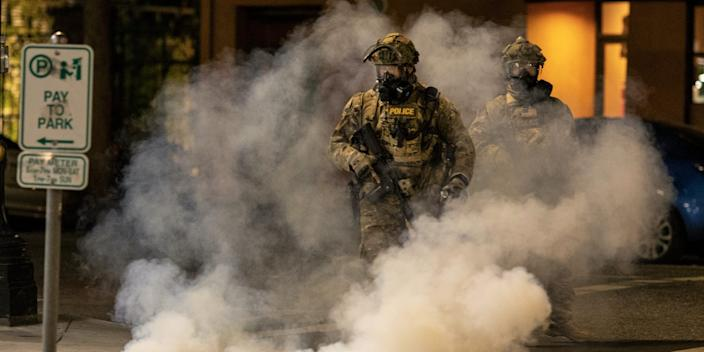 Federal officers operate amid tear gas while clearing the street in front of the Mark O. Hatfield U.S. Courthouse on July 21, 2020 in Portland, Oregon.