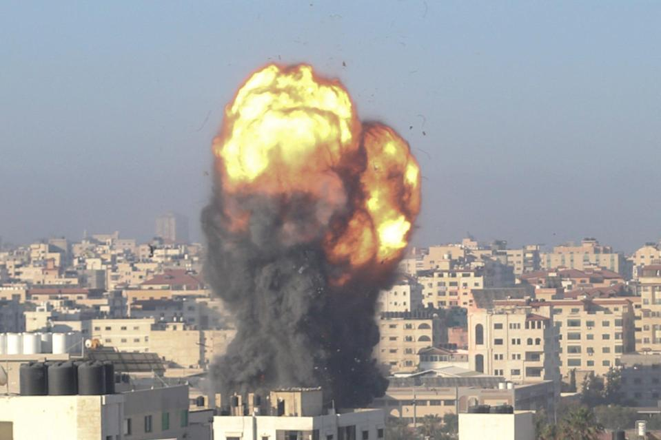 A fireball and smoke billow up into the air during an Israeli airstrike on Gaza City early on Saturday, May 15, 2021. The strike targeted the Ansar compound, which is linked to the Hamas movement in the Gaza Strip.