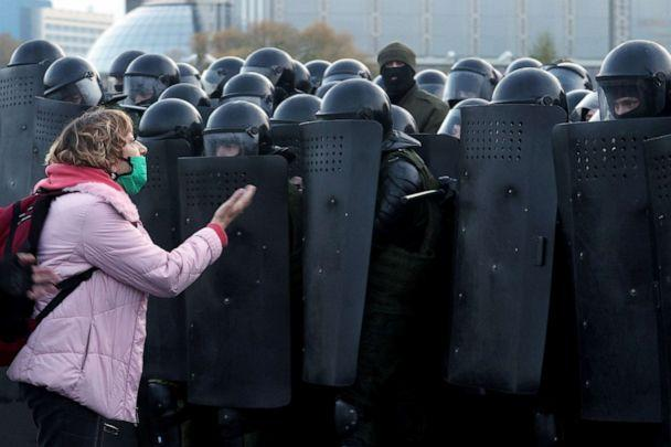PHOTO: A woman argues with law enforcement officers during an opposition rally in Minsk, Belarus, Oct. 25, 2020. (AFP via Getty Images)
